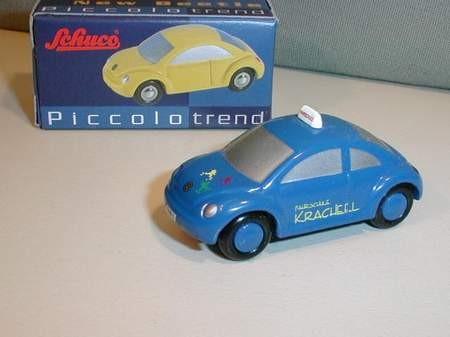 VW New Beetle, Fahrschule, mit Dachschild